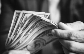 A person carrying a lot of cash by Rawpixel
