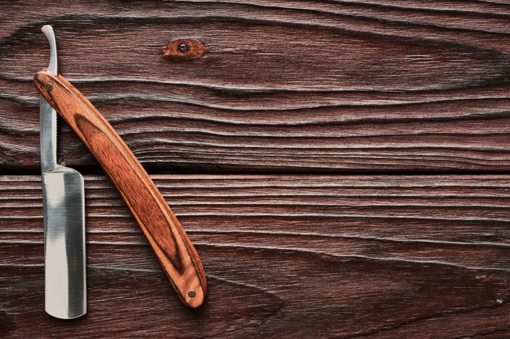 Vintage barber shop straight razor by haveseentool on wooden background