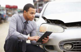 Loss Adjuster Using Digital Tablet In Car Wreck Inspection @monkeybusiness